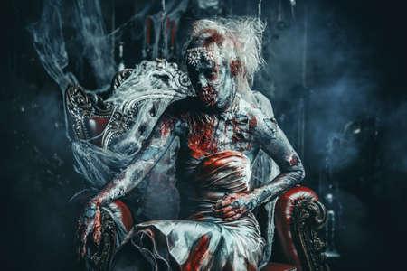 Zombie bride. Bloody dead bride woman in the old abandoned castle. Halloween. Horror. Stock fotó