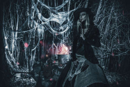 Evil witch conjures in the thicket of the forest. Fairy tales on Halloween.