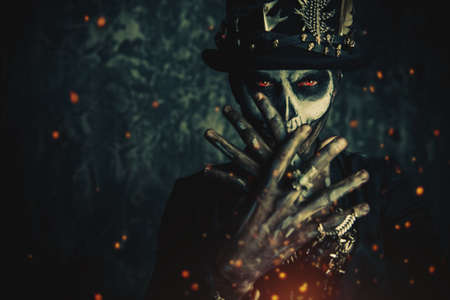 Close-up portrait of a man with a skull makeup dressed in a tail-coat and a top-hat. Baron Saturday. Baron Samedi. Dia de los muertos. Day of The Dead. Halloween. Stock Photo - 88640713