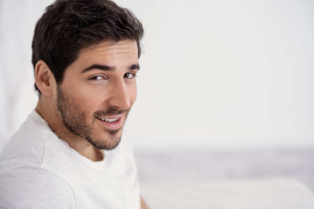 Happy young man looking at camera and smiling. Mens beauty and health. Zdjęcie Seryjne