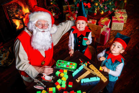 Santa Claus And The Elves Make Gifts For Children At Christmas ...