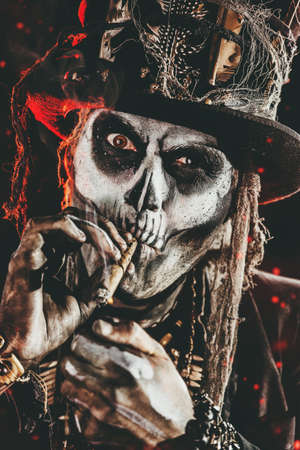 Baron Saturday. Baron Samedi. A man with a skull makeup dressed in a tail-coat and a top-hat. Dia de los muertos. Day of The Dead. Halloween. Stock Photo