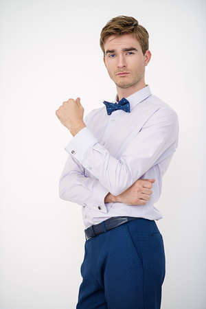 Mens beauty, fashion. Well-groomed young man wearing elegant suit and bow-tie. Stock Photo