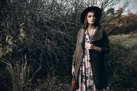 Autumn mood. Beautiful young woman  in autumn clothes posing outdoor.  Seasonal autumn fashion.