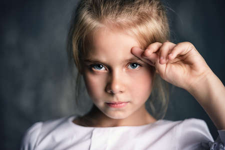 Portrait of a beautiful eight year old girl with calm pensive look. Childhood concept. Reklamní fotografie - 91258417
