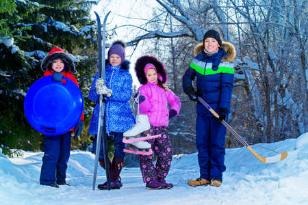 Happy children enjoy sunny winter day. Snow. Winter clothes. Winter activity.
