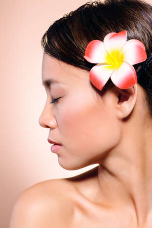 Beauty portrait of a tender asian woman with perfect skin. Healthcare, body care and cosmetics.