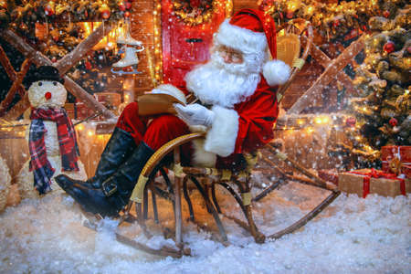 Santa Claus is preparing for Christmas. He writes letters. House of Santa Claus. Christmas decoration.  Stock Photo