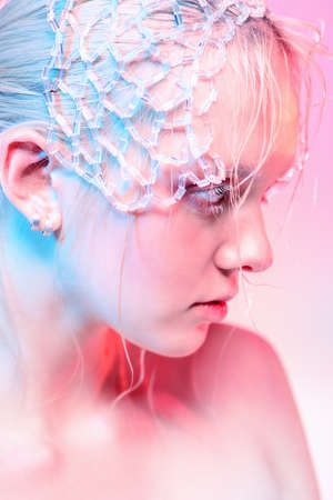 Beauty concept. Beautiful blonde girl with natural makeup and shiny healthy skin over pink background.
