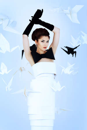 Art fashion photo of a gorgeous woman in paper dress. Black and white. Stock Photo