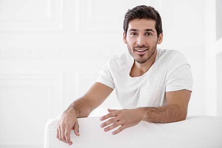 Happy young man looking at camera and smiling. Mens beauty and health. Banco de Imagens