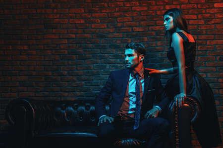 Sexual passionate couple in elegant evening dresses. Luxurious interior. Standard-Bild