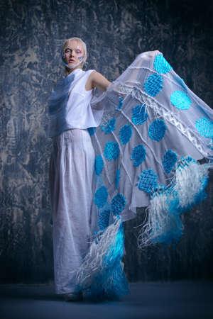 Female beauty, fashion. Full length portrait of a female model posing in stylish clothes. Studio shot.