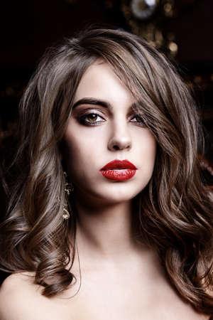 Make-up and cosmetics concept. Pretty sexy girl with bright make-up. Beauty portrait. Studio shot. Foto de archivo
