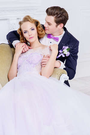 The enamored groom knelt down before his bride. Love concept. Wedding fashion.