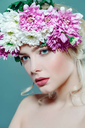 Sensual spring lady in a wreath of flowers. Beauty, cosmetics. Make-up.
