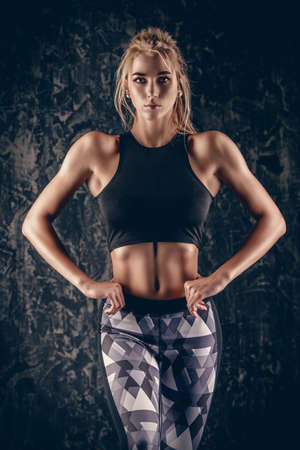 Portrait of a beautiful athletic woman with perfect muscular body. Active, healthy lifestyle. Fitness, bodybuilding. Stock Photo