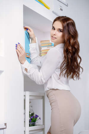 Portrait of a beautiful elegant businesswoman in the office. Fashion, business style.