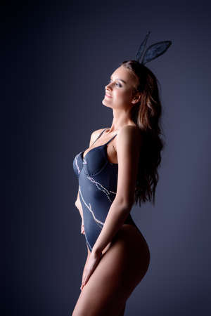 Beautiful sexy woman with ears on her head posing in swimsuit. Beauty, fashion. Make-up.