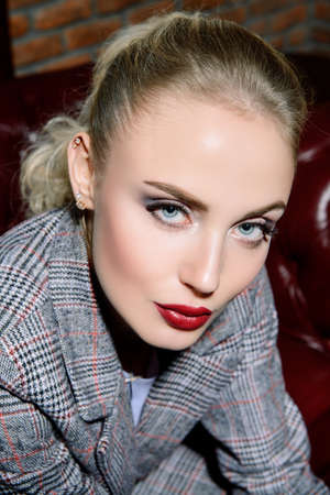Portrait of an attractive girl with bright makeup and red lips. Beauty, make-up, cosmetics.