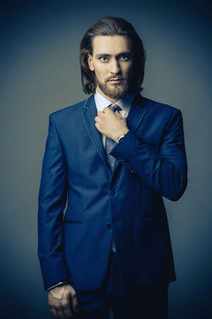 Fashion shot. Handsome young man posing in elegant blue suit and white shirt. Mens beauty, fashion. Stok Fotoğraf