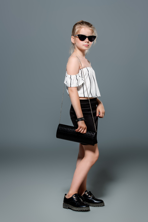 Full length portrait of a cute ten-year-old girl in elegant clothes. Children's fashion. Stok Fotoğraf