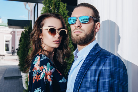 Close-up portrait of a beautiful young people in love in the city. Summer fashion. Фото со стока