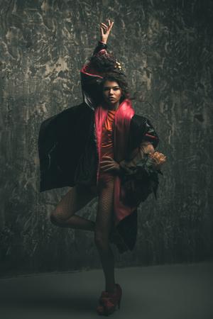 Female beauty, fashion. Full length portrait of a female model posing in stylish clothes. Studio shot over grunge background. 스톡 콘텐츠 - 106686969