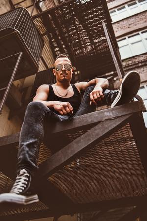 Rock man in the street. Streetstyle. Freedom feeling. Stock Photo