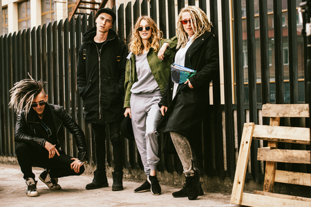 Young fashionable people. Street style. City casual fashion.