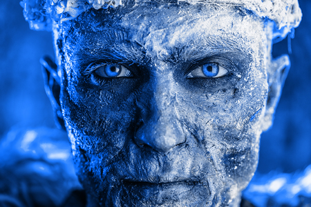 Close-up portrait of The King zombie warrior in the armor of a medieval knight covered with snow. Halloween. Horror fantasy film. Foto de archivo