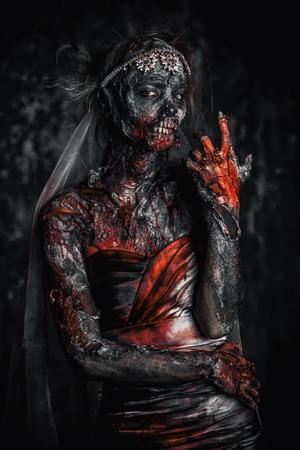 Portrait of a bloody dead bride woman. Zombie bride. Halloween. Horror. 写真素材 - 107417158