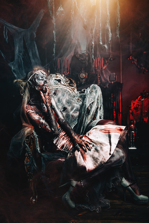 Zombie bride. Bloody dead bride woman in the old abandoned castle. Halloween. Horror. Reklamní fotografie