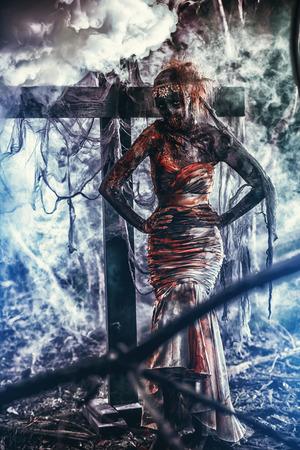 Dead bride woman on an abandoned cemetery. Zombie bride. Halloween. 写真素材 - 107417237