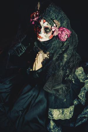 Calavera Catrina in darkness. Sugar skull makeup. Dia de los muertos. Day of The Dead. Halloween. 写真素材