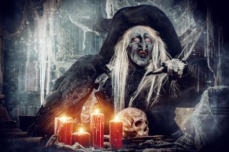 Talking wizard. Halloween. Horror film. Stock Photo