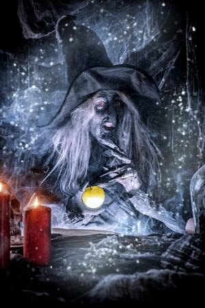 Making a spell. Halloween costume. Horror film.