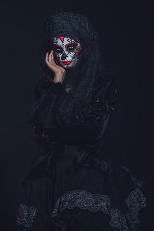 Calavera Catrina in darkness. Sugar skull makeup. Dia de los muertos. Day of The Dead. Halloween. Stock Photo