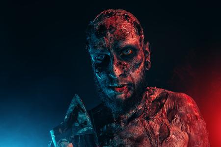 Creepy scary zombie with an axe. Halloween. Horror film.