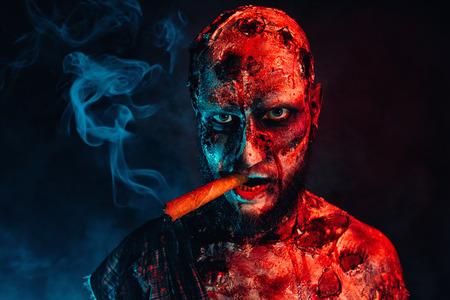 A zombie smoking a cigar. Halloween. Horror film.