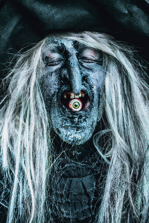 A wizard is eating an eye. Halloween. Horror film.