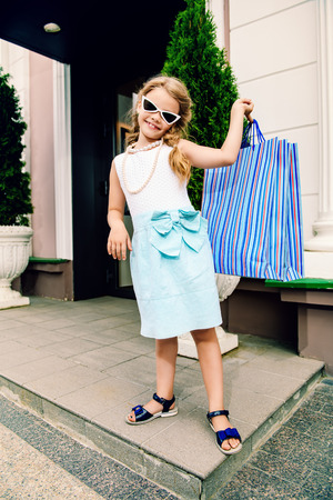 A little girl is doing shopping. Fashion concept. Summer. Stock Photo