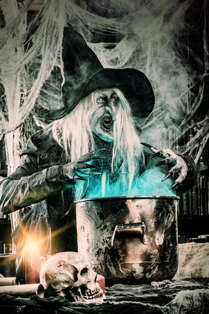 A witch is preparing spell. Halloween costume. Horror movie. 写真素材 - 108635587