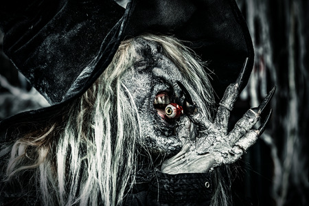 A wizard is eating an eye. Halloween. Horror film. 写真素材 - 108635593