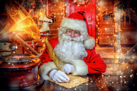 Portrait of Santa Claus writing a letter. Christmas and New Year concept. Stock Photo