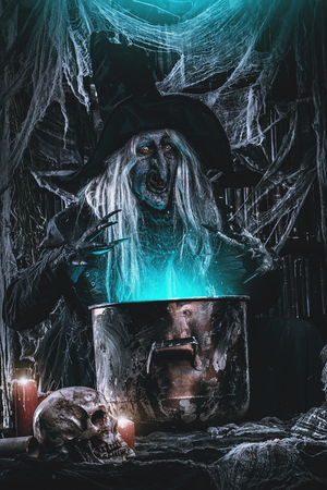 A witch is preparing spell. Halloween costume. Horror movie. 写真素材 - 109281147