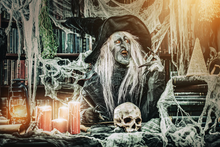Preparing some evil. Halloween concept. Horror film. 写真素材