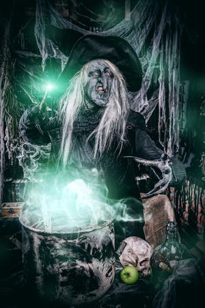 A witch is preparing spell. Halloween costume. Horror movie. 写真素材 - 109178948