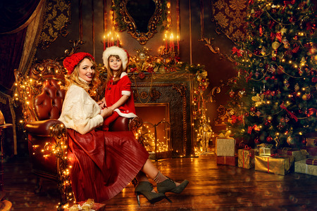 Mom and daughter celebrate Christmas in beautiful decorated apartments. Time for miracles.