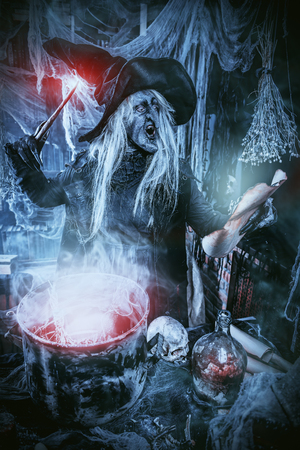 A witch is preparing spell. Halloween costume. Horror movie. 写真素材 - 109178954
